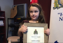 A girl is given Heroism Award