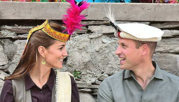 Prince William and Kate wearing Kalasha traditional caps