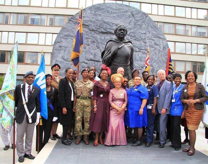 Elizabeth Anionwu with a statue of black nurse Mary Seacole