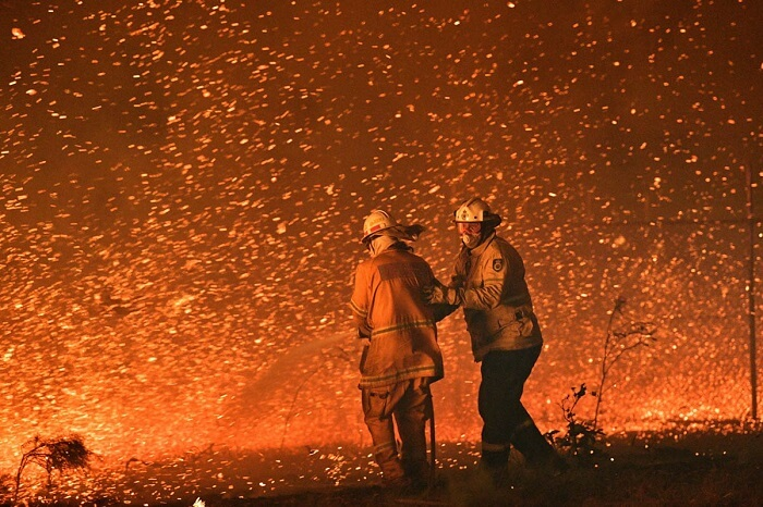 firefighters trying to control Australia bushfire