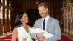 Prince harry and Meghan Markle with their child