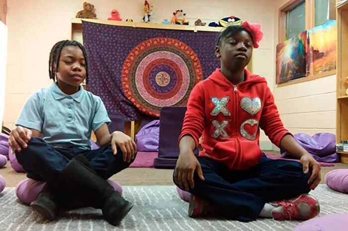 Kids doing meditation
